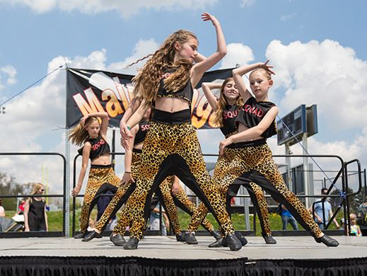Girls dance team performing on stage